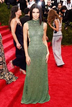 Kendall Jenner in a floor-length green mesh gown with open sides at the 2015 Met Gala