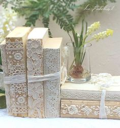 Beautiful prop idea for a craft fair - wrap used books in lace to add feminine or vintage vibe and add depth and height to a table display.