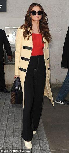 Selena Gomez cream coat red top black trousers cream shoes London 2016 photo Will Goff Photos com