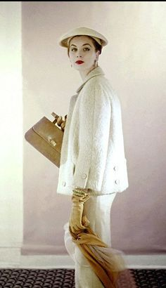 1953 Suzy Parker wearing beige silk box-top jacket over matching dress by Harvey Berin with hat by John Frederics, photo by Clifford Coffin