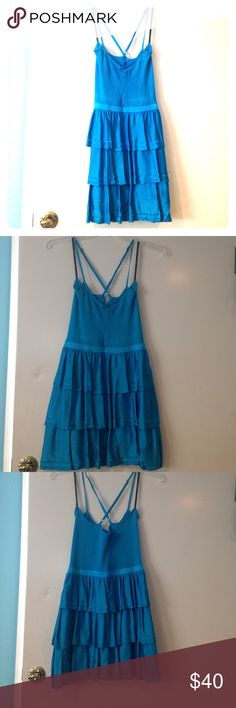 Electric blue party dress Electric blue party dress is perfect for that wow factor. It has some stretch to it, so it can go one someone a size larger. Adjustable cross-cross straps. Waist: 29in bebe Dresses Mini