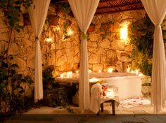 Outdoor spa tub. Rock with subtle lighting and drapes Yes please!!