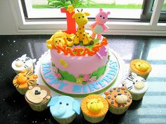 Jungle animal themed cake for a little girl, with animal face cupcakes