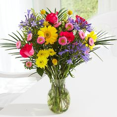 Show your loved ones how much you care by sending this lovely floral arrangement inspired by all the beautiful colors Spring has to offer. This vibrant color composition will not only brighten your loved ones face, but add life to any room you place them in.