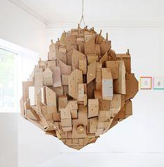 Loving this cardboard sculpture called Floating city by Nina Lindgren.