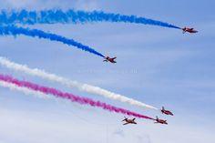RAF Red Arrows in BAE Hawk T1 trainers Farnborough International Airshow Farnborough Airport Rushmoor Hampshire England  www.alamy.com/image-details-popup.asp?ARef=FC323X  #raf #red #team #jet #airplane #air #plane #display #aviation #airshow #force #hawk #arrows #flight #aerobatic #formation #sky #smoke #aircraft #royal #show #teamwork #military #flying #speed #fast #stunt #british #pilot #wing