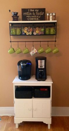 Cute coffee station- Hang some coffee mugs, put others on shelf. Also put glass canisters with drink mixes on shelf.