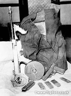 These weapons of John Dillinger, apparently dumped into Lake Michigan after his death were recovered and identified by authorities as the trappings of the outlaw. The machine gun, bullet proof vest and the automatic were the stock and trade of Dillinger during his career.br26th July 1934