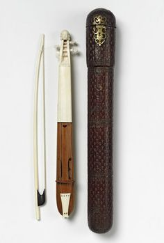 """1670 French Kit at the Victoria and Albert Museum, London - From the curators' comments: """"Kits were small and narrow variants of violins. They were known as pochettes in France because they could easily be fitted in the coat-pocket of a dancing master, who would play briefly on this instrument, slip it into his pocket and then demonstrate the appropriate steps. Very little music was composed specifically for the kit so the performer generally played violin pieces or popular tunes."""""""