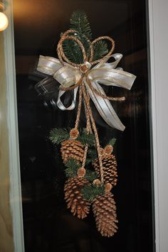 Gold pine cone door decoration