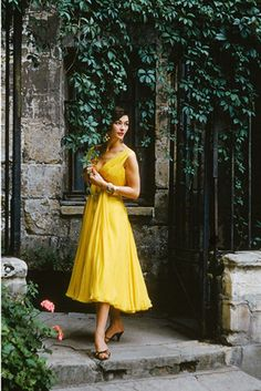 A model wearing a yellow Chanel dress, 1955 Photo by Mark Shaw