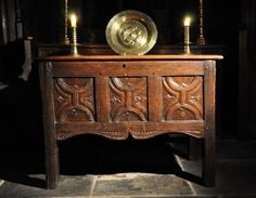 AN EXTREMELY RARE HENRY VIII OAK COUNTER TABLE. ENGLISH.-THE MOULDED TOP NOW HINGED ABOVE A THREE PANELLED FRONT CARVED WITH ENRICHED PARCHEMIN PANELS ABOVE A SHAPED APRON WITH CROSS DECORATION, THE SIDES CARVED WITH HORIZONTAL LINENFOLD.