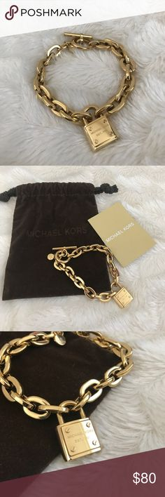 Michael Kors Toggle Braclet Beautiful Michael Kors chain and toggle bracelet with gold lock. This beautiful bracelet has been worn 2-3 times but is in excellent condition! The above picture shows even the smallest detail was not missed in the little diamond near the toggle closure. Comes with dust bag and care booklet. A beautiful piece! Michael Kors Jewelry Bracelets