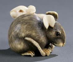 A Japanese ivory netsuke of two mice. Early 19th century. Larger mouse with…