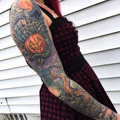 Halloween-themed sleeve tattoo by Norm Wright Jr