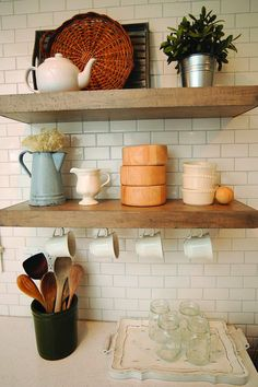 Kitchen shelves can hold a variety of decorative items.