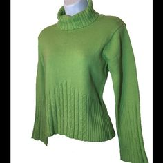 Beautiful Green CATO Sweater Beautiful Green CATO Sweater.  Size Medium.  Measurements:  Bust 18 inches, Waist 16 inches, Length 22 inches.  Bottom of sweater has a nice ribbed design, as well as on the arms.  Excellent pre-owned condition.  Fabric:  94% Acrylic, 6% Spandex. Cato Sweaters