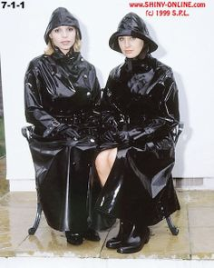 2 girls in shiny raincoats.