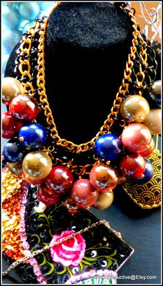 Christmas tree bauble large iridescent multicolour beads festive unusual massive choker necklace set on solid black and gold coloured chunky chains is a special accessory for your unforgettable look this year's Christmas and New Year party. #jewelry #massivejewelry #unusualjewelry #beads #chainnecklace #chokernecklace #accessories