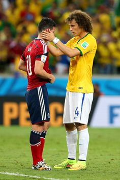 James Rodriguez of Colombia is consoled by David Luiz of Brazil after the 2014 FIFA World Cup Brazil Quarter Final match between Brazil and Colombia at Estadio Castelao on July 2014 in Fortaleza,. James Rodriguez, Soccer Guys, Soccer Stars, Football Players, Basketball, First Football, Football Boys, Fifa, Colombia Soccer