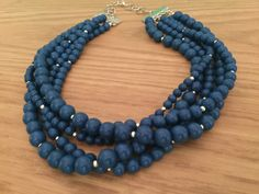 A personal favorite from my Etsy shop https://www.etsy.com/listing/495210716/blue-and-silver-necklace-multistrand