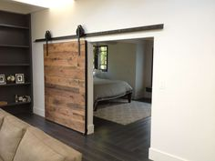 Bedroom:Beautiful Textured Wood Sliding Barn Door Decor Interior Bedroom Dark Grey Wood Floor Also Cream Modern Carpet Design Ideas 2017 Elegant Four-Posted Bedroom Design with Dark Wood Console Table