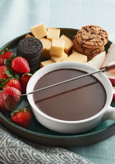 BAKER'S Chocolate Fondue — Melty, delicious chocolate fondue gets an unexpected lift with an infusion of coffee—plus sweetened condensed milk for extra creaminess.