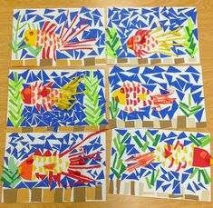 2nd Grade Fish Mosaics     Students in Mrs. Barron's class created marvelous mosaics. Each mosaic is like a puzzle. By cutting and gluing v...