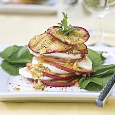 Fresh peaches replace tomatoes in this Southern twist on Insalata Caprese. A drizzle of cilantro vinaigrette spiked with tequila adds the finishing touch.