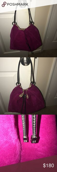 Authentic Kate Spade Purse Gorgeous deep fushia kate spade bag.  Leather straps and leather draw string closure. 1 Interior zipper pocket. 4 silver feet on the bottom to protect the bag. No stains on inside. Perfect color for fall! EUC kate spade Bags Hobos