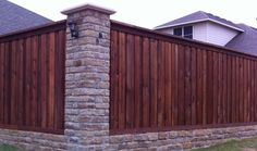 Fence with brick or stone pillars.