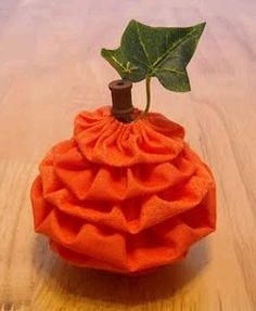 Will definitely be making these this Fall!! Too Cute!  Yo-Yo Pumpkin | AllFreeSewing.com