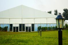 Shelter Event Tent | Golf Open | Frame Tent | 30*50m tent with PVC fabric, clear glass windows wall and double wing glass door. http://www.shelter-structures.com/