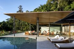 Delta House by Bernardes Arquitetura floating out onto sea lounge