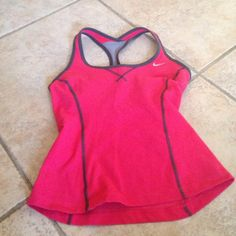 Dri-Fit Nike Workout Tank Top Gently used salmon in color workout top, with bra attached. 62% cotton -body, 31% polyester 7% spandex. Only reasonable offers will be considered No Low Balling. Nike Jackets & Coats