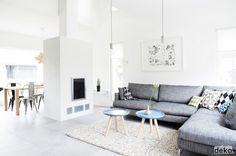 Blues & grey on white, simple coffee tables, grey sofa, geometric pillow, white walls