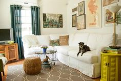 Love the mostly-but-not-quite neutral colors in this room...I want my basement to look like this.