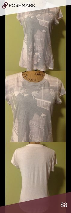 The Beatles t-shirt size SL The Beatles t-shirt size XL(15/17). It is white with the Beatles in gray on front. Short sleeve. 60% cotton 40% polyester. Very good condition The Beatles Tops Tees - Short Sleeve