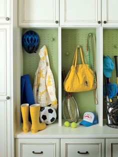 Colorful Backdoor Mudroom from Southern Living - MyHomeIdeas.com: Cubbies and cabinets near the backdoor keep the family organized in this Covington, Louisiana home. (Photo: Laurey W Glenn)