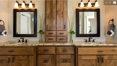 Love the his and hers sinks. The middle cabinet is an absolute must and so practical!