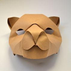 Curve folded lioness mask made by one piece of paper (front view). Paper folding