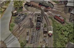 Die Versorgungs- und Behandlungsanlagen von links nach rechts: Klein-Bekohlung (Vollmer), Wasserkran (Kibri), Besandungsanlage und  Schlackenaufzug mit Grube (Vollmer) - sowie eine Diesel-Tankstelle (von Arnold).