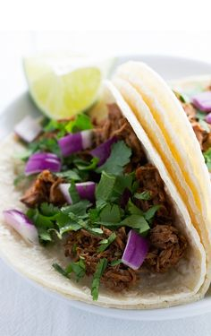 Slow cooker barbacoa beef recipe tastes like Chipotles. Made in the slow cooker to make it extra tender and delicious. Perfect on tacos or burrito bowls!
