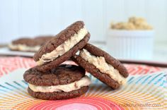 Reese's White Chocolate Brownie Whoopie Pies - brownie cookies filled with a white chocolate Reese's frosting #brownies #reeses
