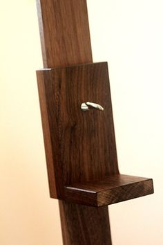 a beautiful tv easel made out of black walnut and finished with a hard