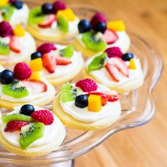 Summer classic in bite-size! These mini fruit pizzas are built on soft sugar cookies and topped with white chocolate cream cheese filling.