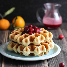 Orange Almond Waffles with Cranberry Syrup- a gorgeous and flavorful holiday breakfast.