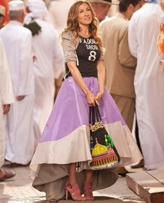 I absolutely adore this outfit from Sex in the City!! Carrie was always able to pull off the most odd pairings and really work it! [Christian Dior tshirt, Zac Posen skirt and underskirt, Manolo Blahnik sandals and a Andrea Lieberman bracelet and Vintage bag] I could go without the bag and work with a clutch.
