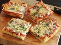 The Best French Bread Pizza from Serious Eats - Slice it up in thin slices for an app that can't be beat. #superbowl #gamedaygrub #kitchenkapers