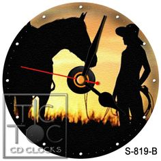 S 819 B  CD CLOCK  COWGIRL AND HORSE  WITH BLACK HANDS